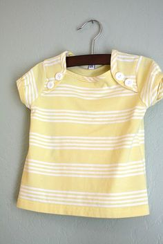 this is the post that gives the details on how to turn an adult t-shirt into an adorable child's top or like the red dress - add a skirt and make a dress.... so cute!