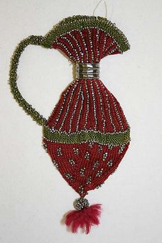 """Pence jug. Mid 19th century. Knit. Green & red silk with steel beads. 6"""" length"""