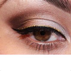 Black and gold eyeliner.Gold is a great color for making green eyes pop.