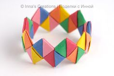 Bracelet out of candy wrappers or paper strips. This would be cool to make out of the Japanese papers!