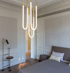 Rudi Loop 02 (2) Loop 01 (1) Custom Configuration (Satin brass) — Rue Pierre Charron, Paris. Designed by Lukas Peet for Roll & Hill