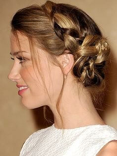 Amber Heard braid w/ messy side bun and loose wisps of hair in the front.