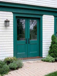 According to Feng Shui principles, you can't go wrong with green, the color of balance and renewal. Don't worry that it will blend in with your landscaping—using green can actually draw out the different shades that are found naturally in your yard. The saturated hue shown is Behr's Precious Emerald.