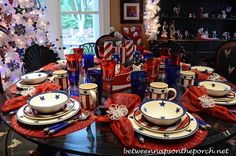 4th of July table with a decked out white leftover holiday tree check t out in the back ground left side awsome