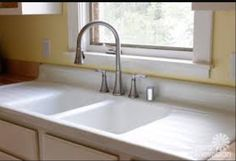 double-basin sink with drainage on each side. These are usually stamped steel, and we can find a vintage one or a reproduction.