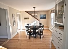 Love the bright & light panel walls & that built in   SoPo Cottage: Dining Room and Foyer: Before and After