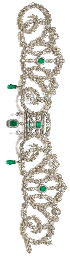 An important Belle Epoque emerald and diamond choker, circa 1900. In the garland style, millegrain-set with cushion-shaped, circular- and single-cut diamonds, accented with variously cut emeralds and two detachable emerald drops, length approximately 335mm, French assay and maker's marks. #BelleEpoque #antique #choker