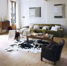Google Image Result for http://cimots.com/wp-content/uploads/2012/05/Stylish-Living-Room-Addition-of-Cowhide-Decoration1.jpg
