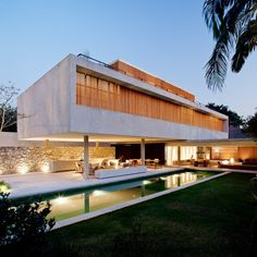 São Paulo, Brazil. Inside-Outside space created by building living space over the outside space. A great way to maximise the use of the plot.