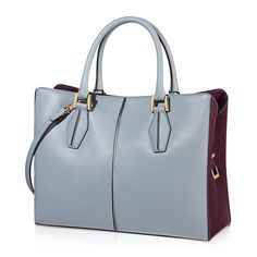 Tod's D-Cube medium shopping bag in elegant smooth leather with contrast-color velvety suede side panels, hand-dyed pipings, rounded twin handles, detachable shoulder strap, metal hardware, partition zip pocket, side compartments with magnetic fastening and silk satin-lined interiors with small pockets.