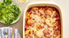 Easy Ravioli Bake - sub homemade sauce; add fresh spinach.  Also try with fresh ravioli with different fillings
