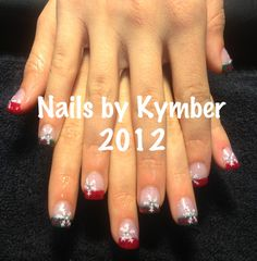 Holiday green and red French with glitter tips, silver highlights, mistletoe snowflakes and rhinestones.  So cute!