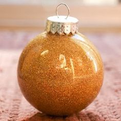 DIY Glitter Ornaments: a simple step-by-step tutorial on how to make these sparkly glitter ornaments.