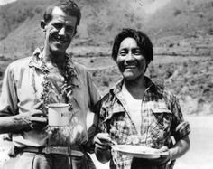 Norgay Tenzing known as Sherpa Tensing Nepalese mountaineer with Edmund Hillary enjoying a snack on their return from the summit.