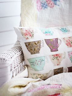 Backporch wicker, grandma's quilts, appliqué teacups pillow. Perfect.