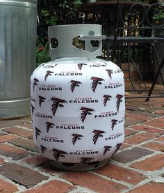 [NOTE: This is not a licensed NFL/Atlanta Falcons product. It is however, hand-crafted from licensed NFL/Atlanta Falcons fabric. I am not affiliated with or sponsored by NFL/Atlanta Falcons.]  A great way to make a propane tank more appealing and/or liven up a party or tailgate while showing your love of the Atlanta Falcons!  Sprayed with UV fabric protector/waterproofing spray to increase durability.  Please note, exposure to the sun can cause fabric to fade