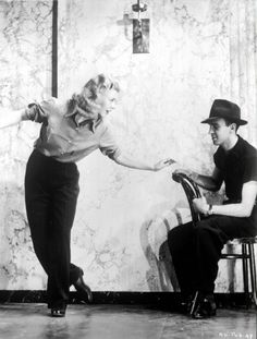 Ginger Rogers and Hermes Pan.  Pan would work out the choreography with Fred Astaire then teach it Ginger, who usually wasn't in on the creative process due to a busier filming schedule.