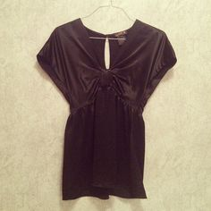 LaRok Silk Bow Top LaRok black silk top with big sleeves and a bow in front. V neck, keyhole at back, invisible zipper at side. Super cute! Dry clean only. Worn lightly - great condition. Size small will also fit and XS. Reduced from $84 LaRok Tops