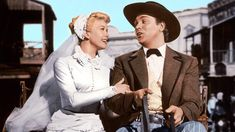 "Ending of ""Calamity Jane"" Spoiler Alert: This is the scene were Wild Bill and Calamity get ""hitched""...Howard Keel was a lot taller than Doris Day measuring in at 6'3 and Doris was only 5'7"
