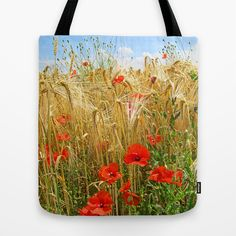 Poppy in a wheatfield Tote Bag nature, agriculture, poppy, poppies, papaver,flower,flora,wheat, cereal, grain, sky, blue, red, yellow,golden,summer,clouds