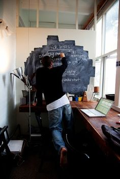 I like 2 things about this. 1) chalkboard paint used somewhat randomly, un framed, non-specific shape. 2) he is barefoot