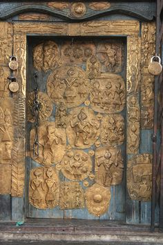 The door of the Shiva temple at Lakhamandal, Uttarakhand, India tells an intricate story through pictures. The three huge padlocks tell another story!