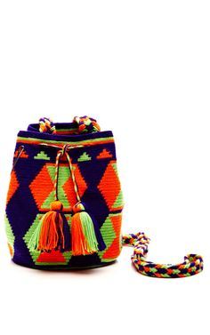 Shop One-Of-A-Kind Handmade Wayu Mini Mochila. This one-of-a-kind handmade woven cotton bag from Muzungu Sisters features a shoulder strap, drawstring closure with tasseled ends and an allover tribal print. Tapestry Bag, Tapestry Crochet, Knit Crochet, Mochila Crochet, Ethnic Bag, Weaving Patterns, Knitted Bags, Cotton Bag, Handmade Bags