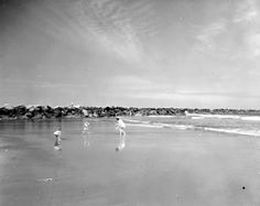 Florida Memory - Beach-goers near jetty - Mayport, Florida 1953