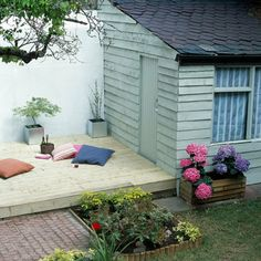 Pale green summerhouse with decking  | Sheds and Summerhouses | Decorating Ideas | Interiors | Red Online