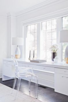 Perfectly styled modern bedroom features a Kartell Ghost Chair placed at a long white lacquer desk positioned under windows and topped with white and gold lamps. Bedroom Desk, Small Room Bedroom, Trendy Bedroom, Small Rooms, White Bedroom Furniture Desk, Furniture Sets, White Desks, White Rooms, White Desk Long
