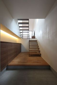 Wood flooring and bare walls.
