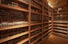 Cigars resting in our state-of-the-art humidor, waiting to paired with an Ashton Signature Cocktail.