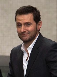 "I love his face!  It's like he's saying, ""I'm adorable, what can I say?"" Outside the ITV Studios - London, 7 March 2013 - Richard Armitage"