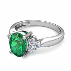 An emerald and diamond engagement ring - this looks so beautiful in white gold. #whitegold #emerald #engagementring #myloveweddingring