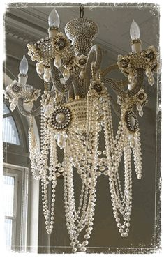 Amazing chandelier idea. could be done with an old chandelier and the cheap faux pearls that look real + salvaged vintage brooches or earrings