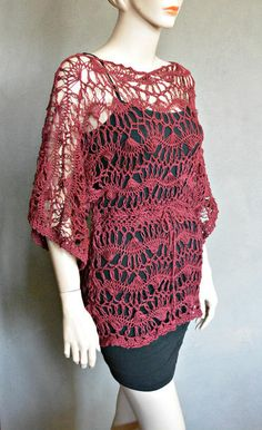 """This is a Beautiful Tunic Made it with Mercerized Cotton in Burgundy  color. It comes with a tie that you can adjust at the waist. The measurements are: 24"""" from shoulder to edge, 33"""" at the waist, and 36"""" across the sleeves. It will fit breast's sizes ..."""