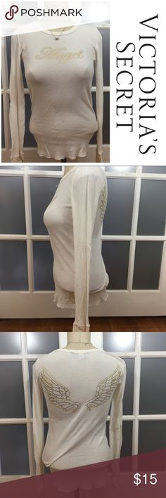 """🎉30% OFF BDLS🎉 Victoria Secret angel thermal top Victoria Secret angel thermal top. Long sleeved white. Says """"angel"""" with sliced gems and gold writing on front and has wings on back. Minor piling but not noticeable   🔹 Material: 60% Cotton, 40% polyester  🔹Colors may vary slightly from pictures. 🔹30% off bundles of 2 or more 🔹Accept reasonable offers 🔹No Trades Victoria's Secret Tops"""