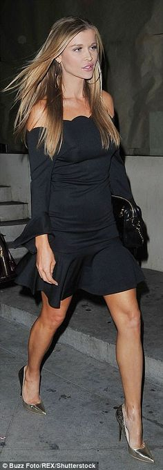 Party frock: Joanna showed off her sensational figure in a sexy off-the-shoulder black number
