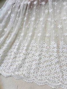 Off white lace fabric embroidery both sides with by lacelindsay