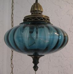 Vintage Blue Glass Blown Glass Swag Hanging Lamp 60's 70'S  My mom used to have two blue ones hanging in her bedroom. The blue light always made me feel calm. Wish she still had them. They were cool
