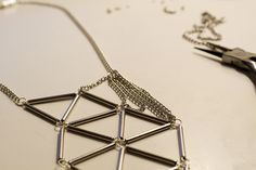 PARK & CUBE | DIY Silver Bugle Geometric Necklace. I think I would use either eye pins or make my own from wire rather than trimming the head off head pins. Also no chain on the pendant part.