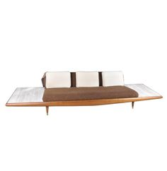 A Mid Century Modern model sofa designed by Adrian Pearsall for Craft Associates, circa This walnut piece features a cushioned back with extended deck on each side with marble inset p. Mid Century Modern Sofa, Mid Century Modern Furniture, Outdoor Sofa, Outdoor Furniture, Outdoor Decor, Adrian Pearsall, Sofa Design, Mid-century Modern, Home Decor