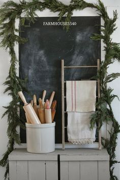 green garland around a chalkboard for Christmas