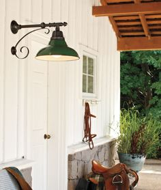 The Carson. Warehouse-style wall bracket, paired with Green hand-spun aluminum dome shade.