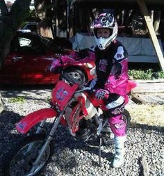 My friend/brother from another brother has the same exact dirt bike in the pic the bike is RED not pink but I am so totally hooked on the pink motocross gear. Totally begging my dad about that! PEACE LOVE AND FUCKING MOTOCROSS!