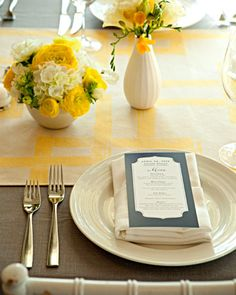 Sweet Centerpiece  Table arrangements for your wedding in sunny yellow hues.     Small arrangements of white and yellow blooms scatter along reception tables.
