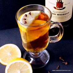 Hot Toddy (Irish Hot Whiskey)  1.5fl oz whiskey 2 teaspoons brown sugar/honey 1 wedge lemon 6 to 8 whole cloves 5 to 6fl oz boiling hot water