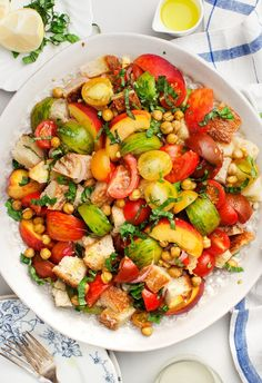 Try this one-bowl panzanella salad with peaches, tomatoes, and sweet corn on its own or as a side dish - perfect for Labor Day or any summer day.