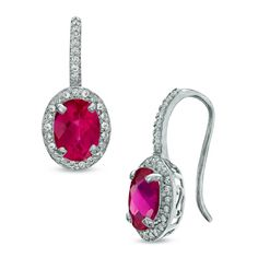 I've tagged a product on Zales: Oval Lab-Created Ruby and White Sapphire Frame Drop Earrings in Sterling Silver