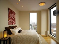 contemporary urban bedroom design // i would die to wake up and look out a window like this. natural light is perfect.